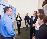 Poster presentation discussion at nursing research event