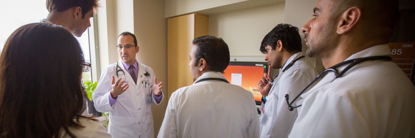 Faculty member with med students
