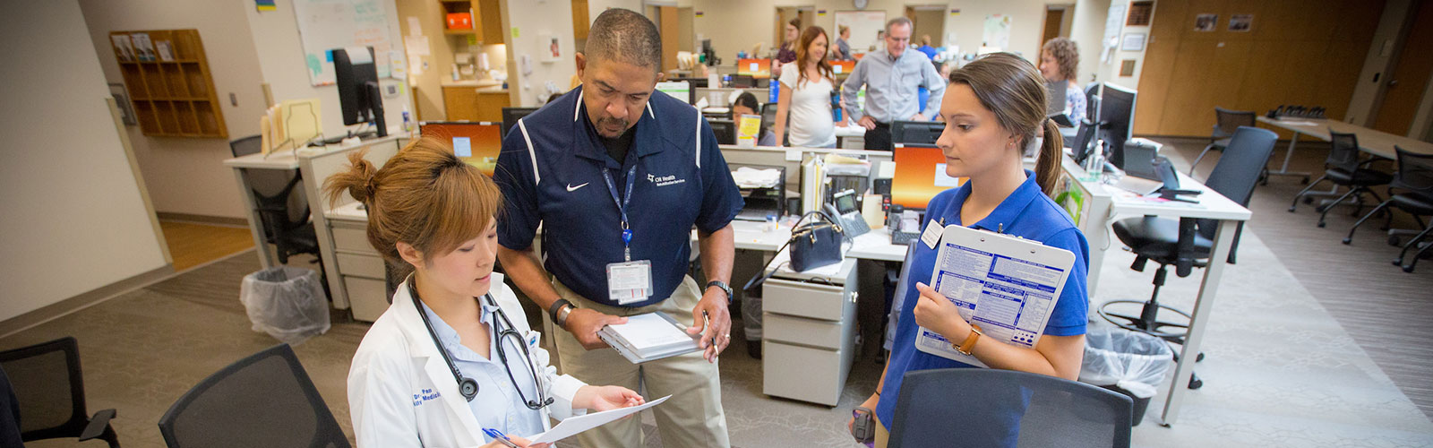 Doctor, physical therapist and nursing student in collaborative setting