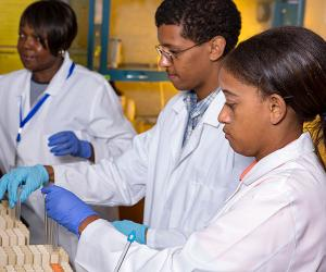 Students and faculty in lab