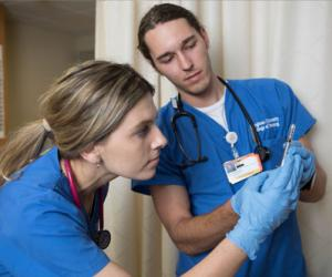 Nursing Students looking over information together